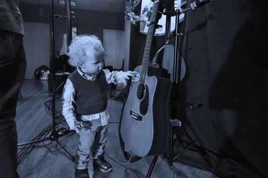 Toddler and guitar
