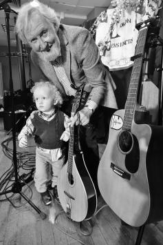 Toddler and sean and guitars black and white